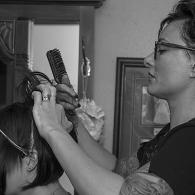 beautician working with a bride upstairs in the bridal suite