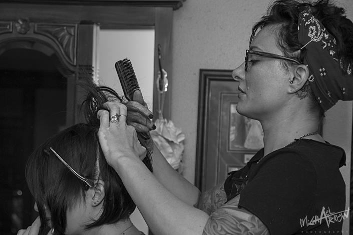 [Image: beautician working with a bride upstairs in the bridal suite]